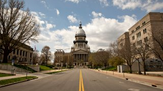 The Illinois State Capitol building stands among empty streets in Springfield, Illinois on April 9, 2020.
