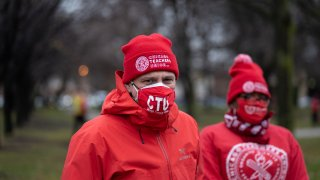Chicago Teachers Union President Jesse Sharkey speaks ahead of a car caravan where teachers and supporters gathered to demand a safe and equitable return to in-person learning during the COVID-19 pandemic in Chicago, IL