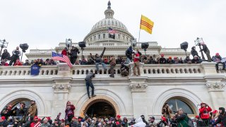 In this Jan. 6, 2021, file photo, protesters seen all over Capitol building where pro-Trump supporters riot and breached the Capitol. Rioters broke windows and breached the Capitol building in an attempt to overthrow the results of the 2020 election.