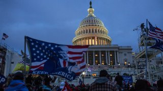 U.S. President Donald Trump supporters gather outside the Capitol building on Jan. 6, 2021. Pro-Trump rioters stormed the US Capitol as lawmakers were set to sign off Wednesday on President-elect Joe Biden's electoral victory in what was supposed to be a routine process headed to Inauguration Day.