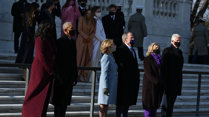 (L-R) Former US First Lady Michelle Obama former US President Barack Obama, former US First Lady Laura Bush, former US President George W. Bush, former US First Lady and Secretary of State Hillary Clinton and former US President Bill Clinton arrive at Arlington Cemetery in Arlington, Virginia, on January 20, 2021, for a wreath laying ceremony with US President Joe Biden and Vice President Kamala Harris.