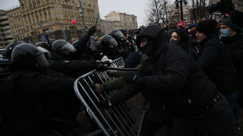 Russian policemen clash with participants of an unauthorized protest rally
