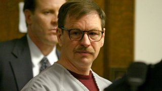 SEATTLE - DECEMBER 18: Gary Ridgway prepares to leave the courtroom where he was sentenced in King County Washington Superior Court December 18, 2003 in Seattle, Washington. Ridgway received 48 life sentences, with out the possibility of parole, for killing 48 women over the past 20 years in the Green River Killer serial murder case.