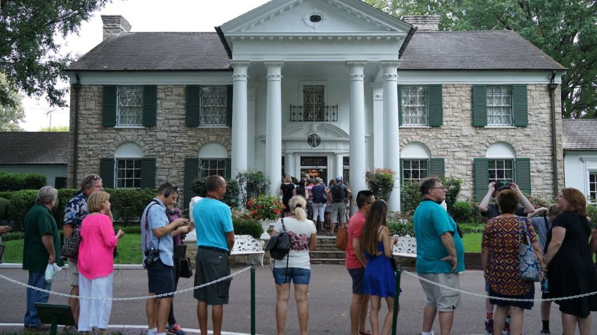 Visitors queue to enter the Graceland mansion of Elvis Presley