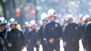 Riot police, blurred