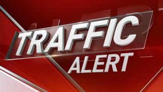 Traffic alert written on red screen