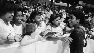 In this June 5, 1983, file photo, Dianne Durham, right, of Gary, Ind., gives autographs after winning the women's title at the McDonald's U.S.A. Gymnastic Championships at the University of Illinois in Chicago. Durham, the first Black woman to win a USA Gymnastics national championship, died on Thursday, Feb. 4, 2021, She was 52.