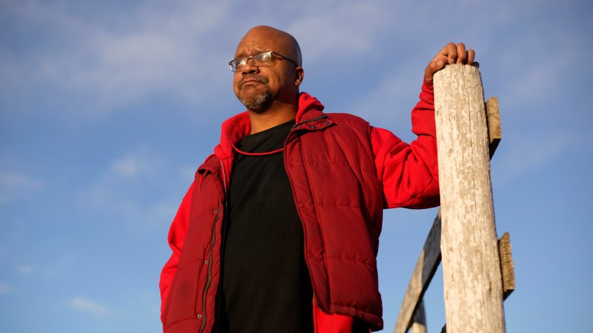 "Lateef Dowdell stands on land once belonging to his uncle Gil Alexander, who was the last active Black farmer in the community of Nicodemus, Kan., Thursday, Jan. 14, 2021. Dowdell moved back to Nicodemus, a settlement founded by former slaves known as ""exodusters"" in the 1870s, several years earlier to take over the farm after his uncle died, but soon after lost most of the land when the bank foreclosed. New legislation in Congress aims to remedy historical inequities in government farm programs that have helped reduce the number of Black farmers in the United States from about a million in 1920 to less than 50,000 today."