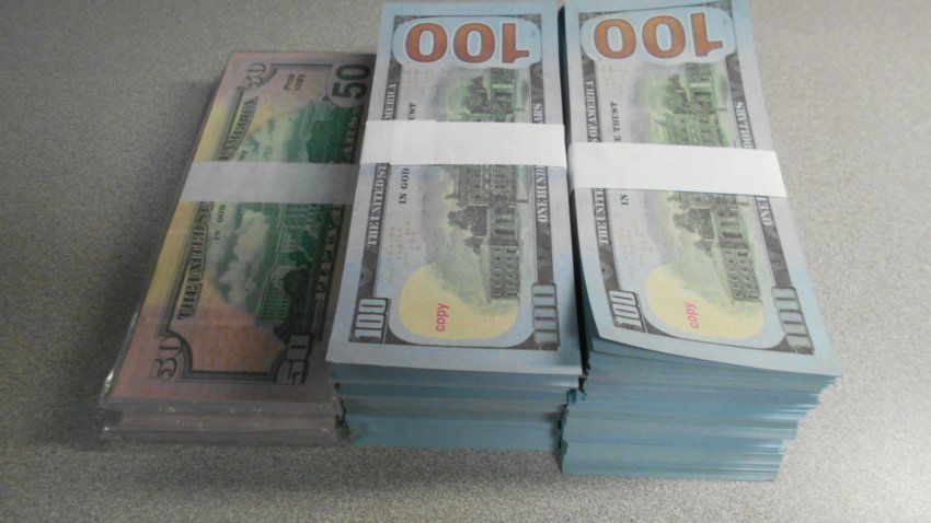 A stack of counterfeit 100 and 50 dollar bills is shown in a photo from United States Customs and Border Protection