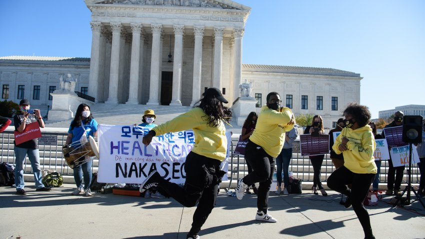 """Dancers perform in front of the US Supreme Court in Washington, DC, on November 10, 2020, as the high court opened arguments in the long-brewing case over the constitutionality of the 2010 Affordable Care Act, under which then-president Barack Obama's government sought to extend health insurance to people who could not afford it. - President Donald Trump's outgoing administration took aim in the US Supreme Court Tuesday at razing the """"Obamacare"""" health program his predecessor built, a move which could cancel the health insurance of millions in the middle of the Covid-19 pandemic."""