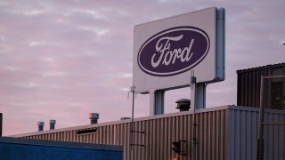 CHICAGO, ILLINOIS - FEBRUARY 03: The Ford company logo is displayed on a sign outside of the Chicago Assembly Plant on February 03, 2021 in Chicago, Illinois. Ford has cut production at the facility from three shifts to one as an ongoing microchip shortage continues to take a toll on the auto industry.