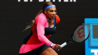 United States' Serena Williams runs to return a shot to Germany's Laura Siegemund during their first round match at the Australian Open tennis championship in Melbourne, Australia, Monday, Feb. 8, 2021.