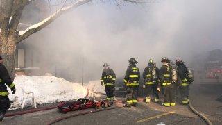 Firefighters battle a blaze in Bridgeport