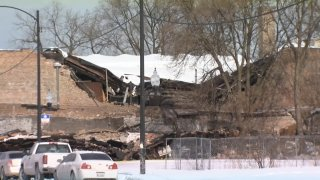 Chicago fire personnel are on the scene of a building collapse, as the roof of a building caved in because of heavy snow