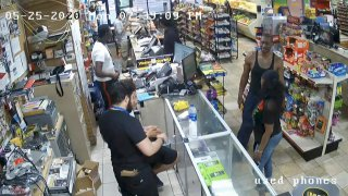 In this image from store video, George Floyd, right, is seen inside Cup Foods on May 25, 2020, in Minneapolis.