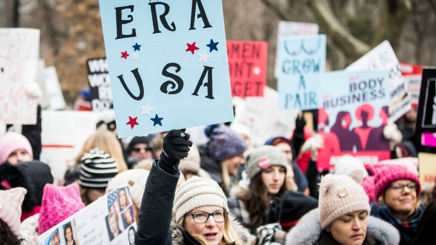 "MANHATTAN, NY - JANUARY 18: A marcher holds a sign that say, ""ERA USA"" during the Woman's March in the borough of Manhattan in NY on January 18, 2020, USA. On April 15, 2020 Hulu is launching a series entitled ""Mrs. America"" which tells the story of the movement to ratify the Equal Rights Amendment (ERA), and the unexpected backlash led by a conservative woman named Phyllis Schlafly, Through the eyes of the women of the era -- both Schlafly and second-wave feminists Gloria Steinem, Betty Friedan, Shirley Chisholm, Bella Abzug and Jill Ruckelshaus -- the series explores how one of the toughest battlegrounds in the culture wars of the '70s helped give rise to the Moral Majority and forever shifted the political landscape."