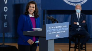 """Michigan Governor Gretchen Whitmer introduces Democratic Presidential Candidate Joe Biden to speak at Beech Woods Recreation Center in Southfield, Michigan, on October 16, 2020. - Joe Biden on October 16, 2020 described President Donald Trump's reluctance to denounce white supremacists as """"stunning"""" in a hard-hitting speech in battleground Michigan with 18 days to go until the election."""