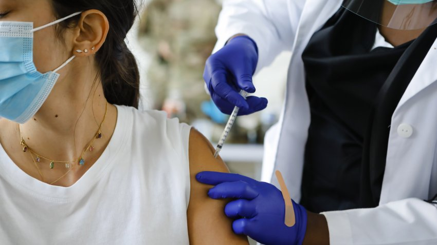 In this March 10, 2021, file photo, a healthcare administers a dose of the Pfizer-BioNTech COVID-19 vaccine at a vaccination center at the Miami Dade College North Campus in North Miami, Florida.