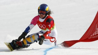 In this file photo, Julie Pomagalski from France speeds down the course 23 February, 2006 during the Turin 2006 Winter Olympics Ladies' Parallel Giant Slalom in Bardonecchia, Italy.