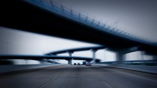 File image of a blurry view of a highway.