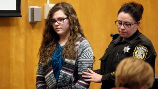 FILE - In this Dec. 21, 2017, file photo, Anissa Weier, one of two Wisconsin girls who tried to kill a classmate to win favor with a fictional horror character named Slender Man, is led into Court for her sentencing hearing, in Waukesha, Wis. Weier, is scheduled to appear Wednesday, March 10, 20201, before the Waukesha County Circuit Court judge who earliersentenced her to 25 yearsin a mental health institution and ask for her conditional release.
