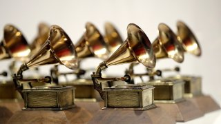 In this Oct. 10, 2017, file photo, various Grammy Awards are displayed at the Grammy Museum Experience at Prudential Center in Newark, New Jersey.