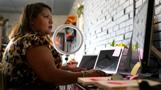 Irma Chavez works in her home office, Tuesday, March 9, 2021, in Springdale, Ark. Chavez came to the United States from her home in El Salvador in 1994 when she was 18 and later was granted temporary protected status.
