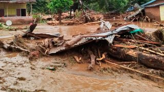 Debris litter an area hit by flash flood in East Flores, Indonesia