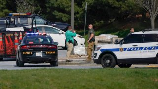 Police talk near the scene of a shooting at a business park in Frederick