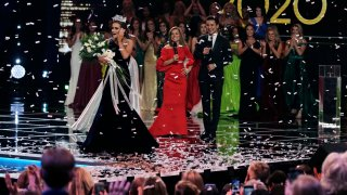 Camille Schrier, of Virginia, left, reacts after winning the Miss America competition