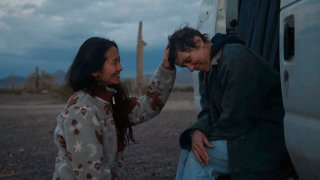 "Director Chloe Zhao, left, appears with actress Frances McDormand on the set of ""Nomadland."""