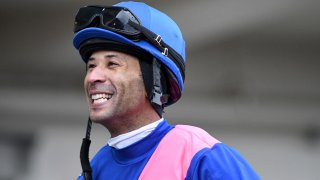 This photo provided by NYRA shows Kendrick Carmouche smiling in the paddock at Aqueduct Racetrack in the Queens borough of New York on Jan. 24, 2020. Carmouche is set to ride Bourbonic in the Kentucky Derby, the first Black jockey in the race since 2013.