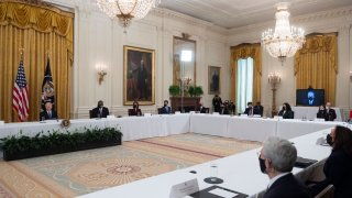 US President Joe Biden (L) holds his first cabinet meeting in the East Room of the White House in Washington, DC, on April 1, 2021.