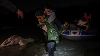 Hundreds of migrants from Honduras, Guatemala and El Salvador arrives in the U.S. after crossing the Rio Grande river from Mexico aboard, in Roma, Texas, United States on April 9, 2021.