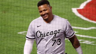 White Sox catcher Yermin Mercedes, pictured in a gray White Sox jersey with black cursive lettering, smiles after racking up yet another hit in a game against the Angels