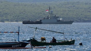 Indonesian Navy ship KRI Singa sails to take part in the search for submarine KRI Nanggala that went missing while participating in a training exercise on Wednesday, off Banyuwangi, East Java, Indonesia, Thursday, April 22, 2021. Indonesia's navy ships are intensely searching the waters where one of its submarines was last detected before it disappeared, as neighboring countries are set to join the complex operation.