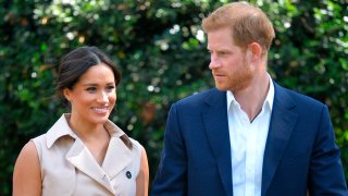 FILE - In this Oct. 2, 2019 file photo, Britain's Harry and Meghan, Duchess of Sussex arrive at the Creative Industries and Business Reception at the British High Commissioner's residence, in Johannesburg, South Africa.