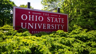 FILE - This May 8, 2019, file photo, shows a sign for Ohio State University in Columbus, Ohio. Ohio State University said Tuesday, Oct. 13, 2020, it will pay $5.8 million to settle lawsuits by about two dozen more survivors over decades-old sexual abuse by a now-deceased team doctor, Richard Strauss.