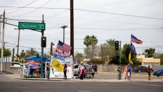 Protestors in support of former President Donald Trump gather outside Veterans Memorial Coliseum where Ballots from the 2020 general election wait to be counted on May 1, 2021 in Phoenix, Arizona.