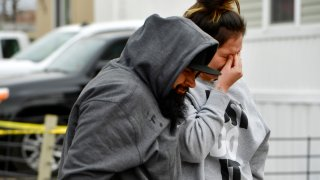 COLORADO SPRINGS, COLORADO - MAY 9: Freddy Marquez, left, walks walks his wife Nubia whose mother was one of six shooting victims, away from the scene of the shooting at the Canterbury Mobile Home Park on May 9, 2021 in Colorado Springs, Colorado. A gunman killed six people at a family birthday party before taking own life, police said. The victims were all members of the same extended family a party attendee said. The shooting was in the 2800 block of Preakness Way in the Canterbury Mobile Home Park. The shooting happened just after midnight. Colorado Springs police Lt. James Sokolik said in a news release. Investigators believe the shooter, who has not been publicly identified, was the boyfriend of a woman at the party.