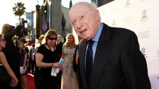 """In this March 26, 2015, file photo, Norman Lloyd poses before a 50th anniversary screening of the film """"The Sound of Music"""" at the opening night gala of the TCM Classic Film Festival in Los Angeles. Lloyd, the distinguished stage and screen actor known for his role as a kindly doctor on TV's """"St. Elsewhere,"""" has died at 106. Manager Marion Rosenberg said the actor died Tuesday, May 11, 2021, at his home in the Brentwood neighborhood of Los Angeles."""