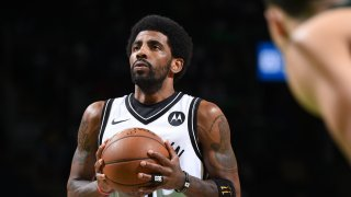 Kyrie Irving shoots the ball against the Boston Celtics during Round 1, Game 3 of the 2021 NBA Playoffs