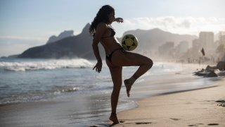 "Catharina Michel plays ""altinha,"" a popular beach game with a soccer ball, on Arpoador beach Rio de Janeiro, Brazil"