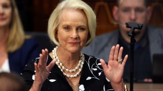 FILE - In this Jan. 13, 2020, file photo Cindy McCain, wife of former Arizona Sen. John McCain, waves to the crowd after being acknowledged by Arizona Republican Gov. Doug Ducey during his State of the State address on the opening day of the legislative session at the Capitol in Phoenix. Cindy McCain is going to bat for Joe Biden, lending her voice to a video set to air on Tuesday, Aug. 18, during the Democratic National Convention programming focused on Biden's close friendship with her late husband, Sen. John McCain.