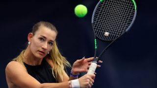 """Russian Yana Sizikova poses for a photo during the Winter Moscow Open 2021 tennis tournament in Moscow, Russia, Wednesday, Feb. 24, 2021. The Paris prosecutor's office says a tennis player suspected of match-fixing last year has been arrested during the French Open. French newspaper Le Parisien reports that the player is 765th-ranked Yana Sizikova of Russia. The prosecutor's office tells The Associated Press that a """"women's international player"""" was in custody but it did not identify her. The prosecutor's office says the player was arrested Thursday, June 3, 2021 on charges of """"sports bribery and organized fraud for acts likely to have been committed in September 2020."""