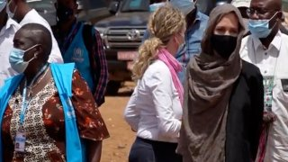 In this image taken from video, Special Envoy to the United Nations High Commissioner for Refugees Angelie Jolie, right, visits the Malian refugee camp in Goudebo, Burkina Faso, Sunday June 20, 2021, to mark World Refugee day on Sunday. Hollywood actress Angelina Jolie has visited war-weakened Burkina Faso to show solidarity with people who continue to welcome the displaced, despite grappling with their own insecurity, and said the world isn't doing enough to help.