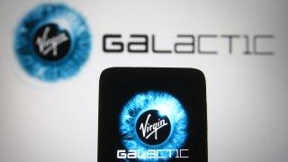 Photo illustration of the Virgin Galactic logo.