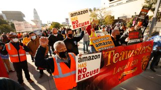 Jose Haro, Felipe Medina and Lou Villalvazo, left to right, with Teamsters Local 63 joined union workers as they rallied in downtown Los Angeles Monday morning in support of unionizing Alabama Amazon workers.