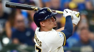 Willy Adames #27 of the Milwaukee Brewers hits a grand slam against the Chicago Cubs in the fourth inning at American Family Field on June 30, 2021
