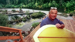 Surfing great Greg Noll on his deck at home that overlooks the Smith River near Crescent City.
